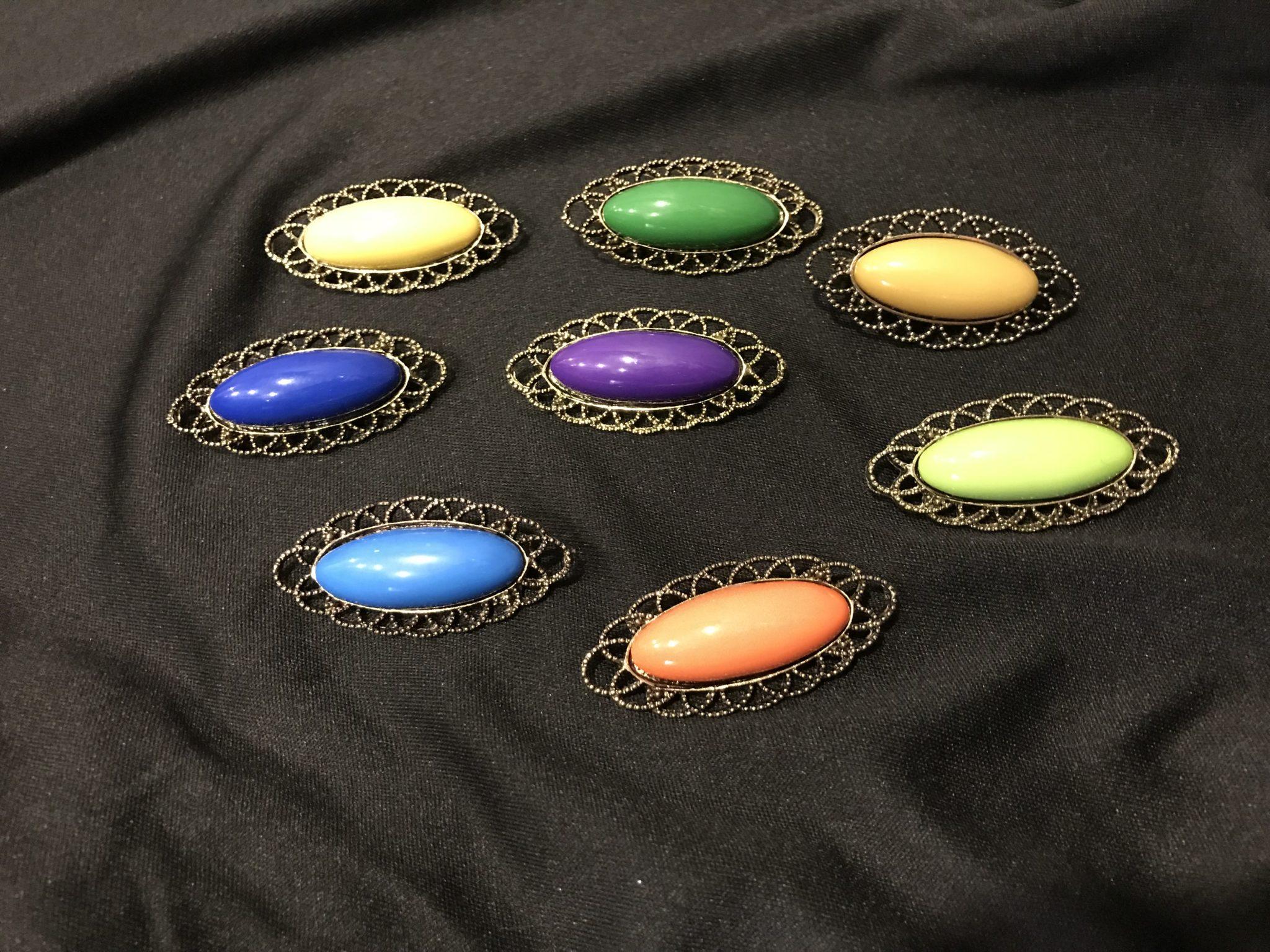 Broche flamenco ovalado en varios colores