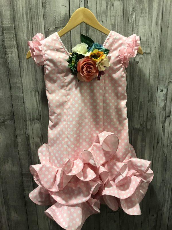 Traje flamenco niña barato sin manga de lunar blanco y fondo rosa tipo Marisol