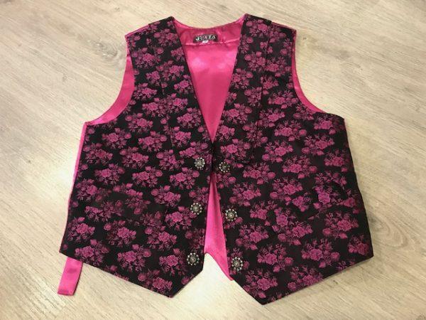 Chaleco huertano fucsia/negro con solapa y un brocado precioso de flores.