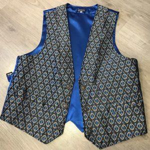 Chaleco huertano azul y negro brocado con bolsillos delantero