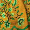 Refajo huertana señora en color mostaza y bordadas sus flores en tonos verdes matizadas