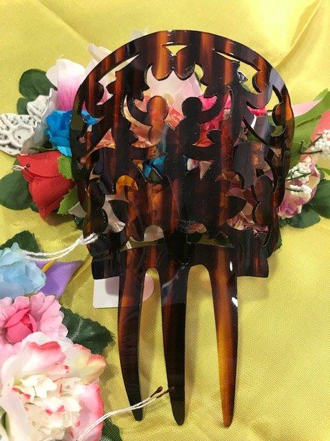 Peineta huertana de concha para niña con preciosos dibujos tornados de plástico