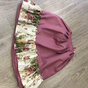 Zagalejo flores para niña con volante de flores variadas en color y falda rosa