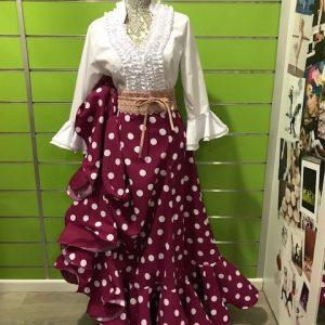 Preciosa falda flamenca Triana de la talla 40 a lunares blancos sobre fondo buganvilla