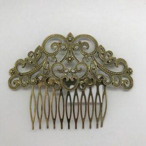 Peinecillo de flamenca en oro viejo con formas ovaladas y filigranas