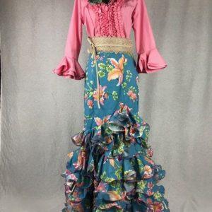 Preciosa falda azul con flores de colores y cinturilla alta