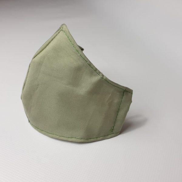 Mascarillas de tela en verde reutilizables y lavables para colocar filtro