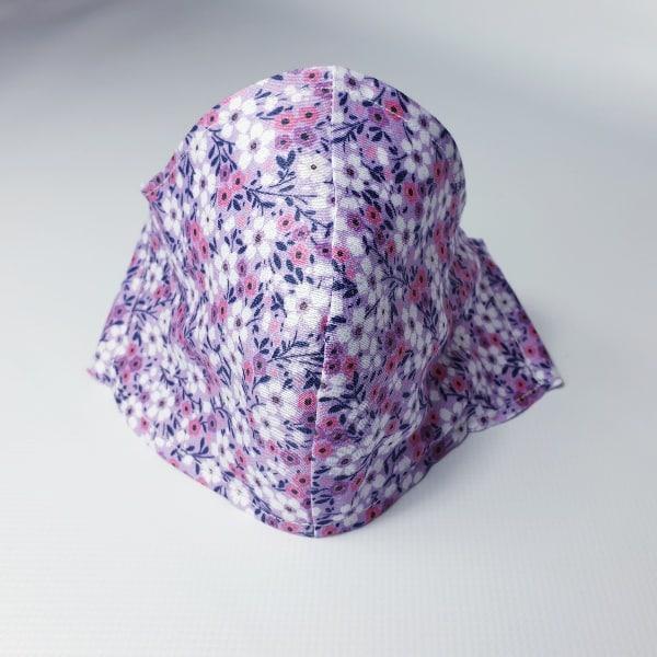 Mascarilla florecillas de tela con filtro desechable incluido