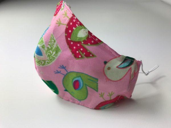 Mascarilla rosa con pollitos para niña con elásticos regulables