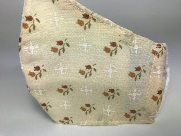 Mascarilla beige cob flores y forro para colocar filtro incluido de 16 horas